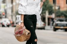 With black pants, ankle strap sandals and straw bag