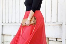 With black shirt, brown clutch and leopard flats