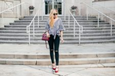 With black skinny pants, marsala bag and red shoes