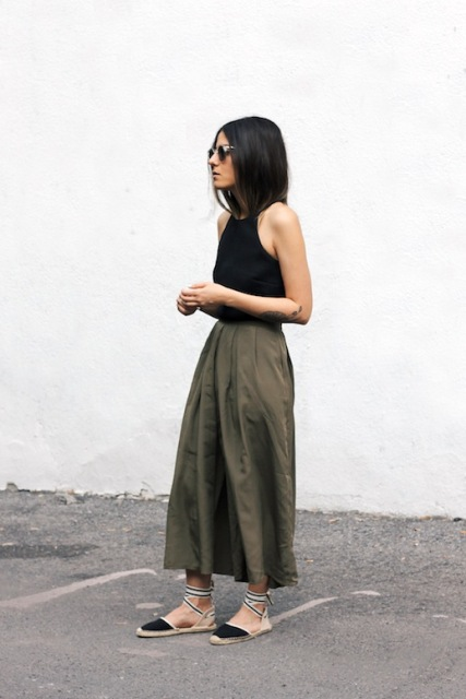 With black top and olive green maxi skirt