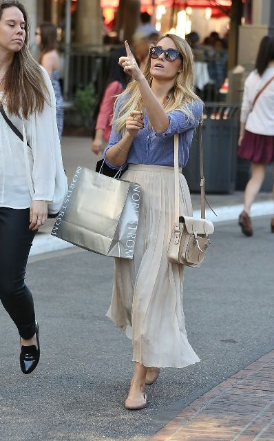 With blue shirt, beige bag and flats