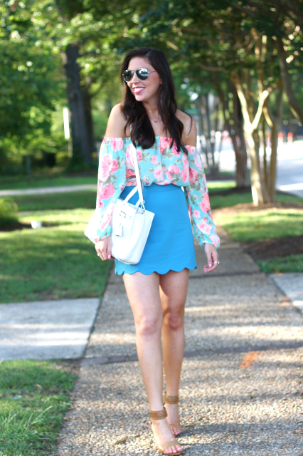 With blue skirt, white bag and heels