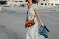 With brown suede bag, lace up sandals and denim jacket