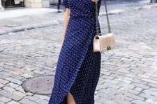 With chain strap bag, sunglasses and heels