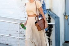 With crop top, brown bag and flats