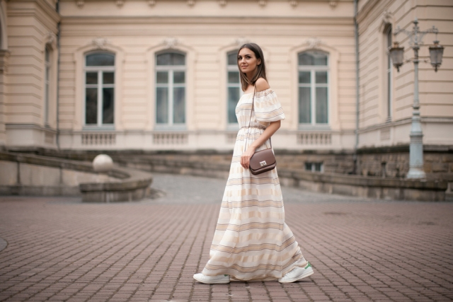 With crossbody bag and white sneakers