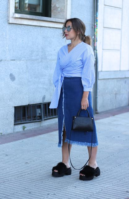 With denim midi skirt, platform sandals and black bag