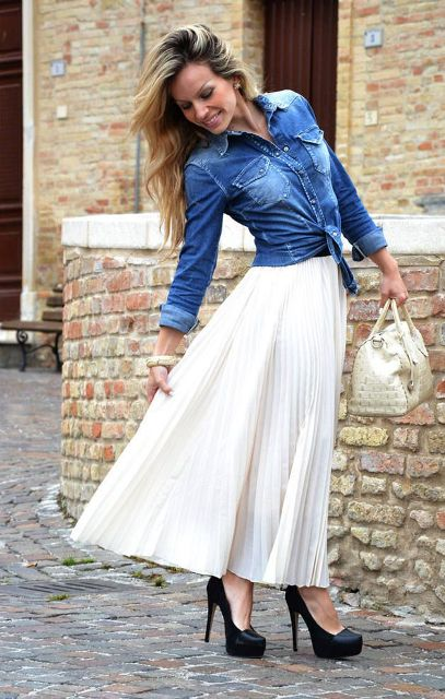 With denim shirt, black high heels and white bag