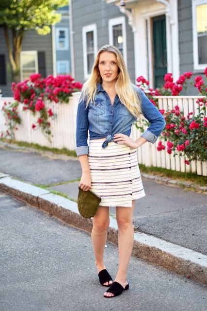 With denim shirt, black mules and mini clutch