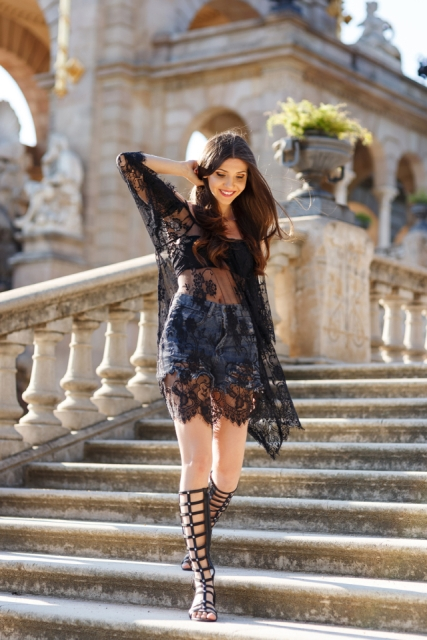 With denim shorts, black top and black lace blouse
