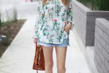 With denim shorts, brown bag and lace up shoes