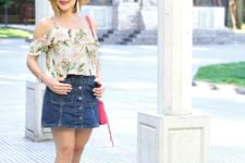With denim skirt, lace up flat sandals, hat and red bag