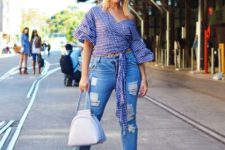 With distressed jeans, unique bag and white printed mules