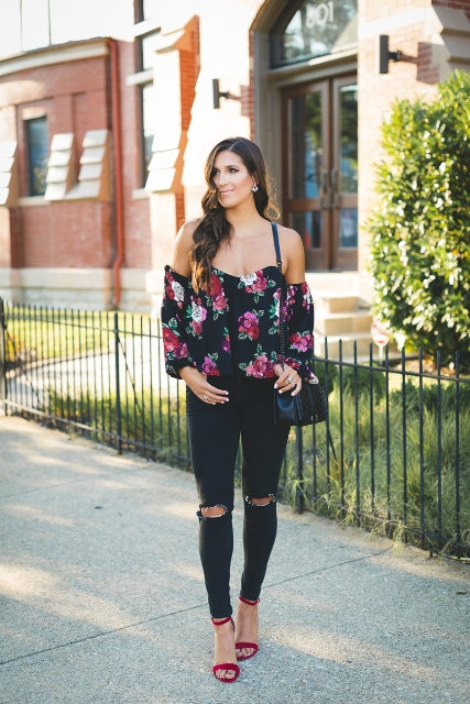 With distressed pants, red sandals and black bag