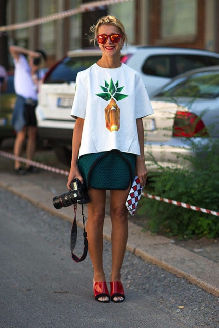 With emerald skirt, red mules and printed clutch