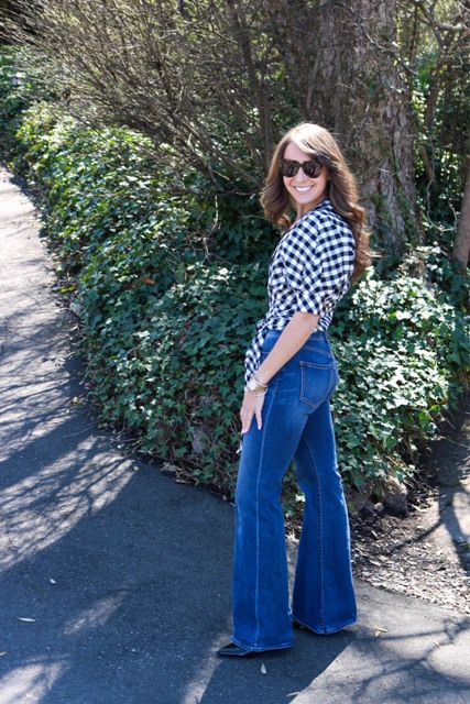 With flare jeans and black shoes