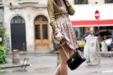 With floral dress and chain strap bag