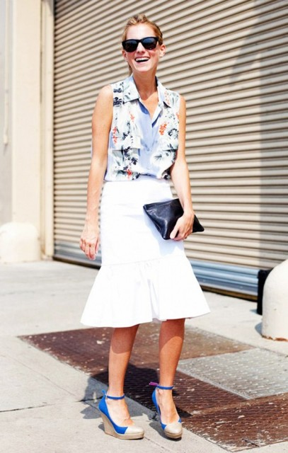 With floral top, white skirt and black clutch
