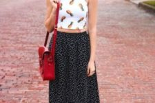 With fruit printed top, red bag and white flat shoes