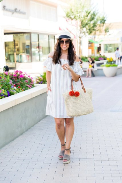 With gray suede shoes, white tote and black and white hat