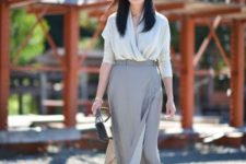 With gray wrapped skirt, sandals and mini bag