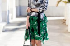 With green skirt, chain strap bag and black pumps