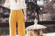With high-waisted trousers and heels
