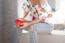 With jeans, red shoes and red mini bag