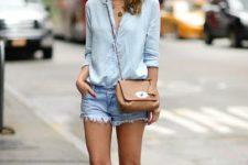 With light blue shirt, beige bag and denim shorts