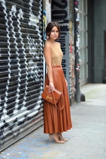 With light brown top, brown bag and beige pumps