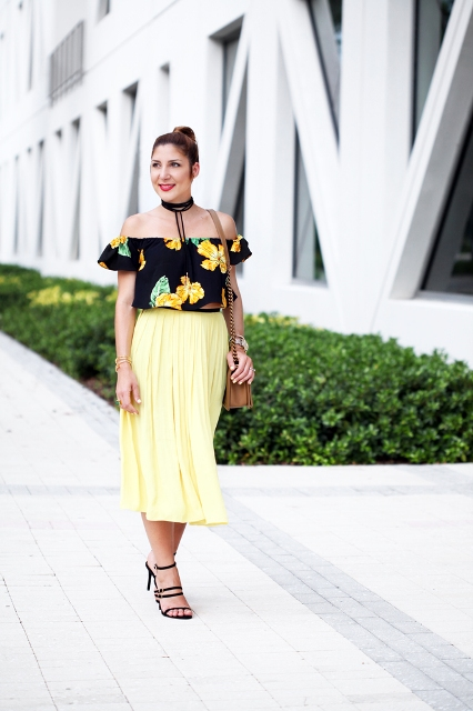With light yellow midi skirt, brown bag and black sandals