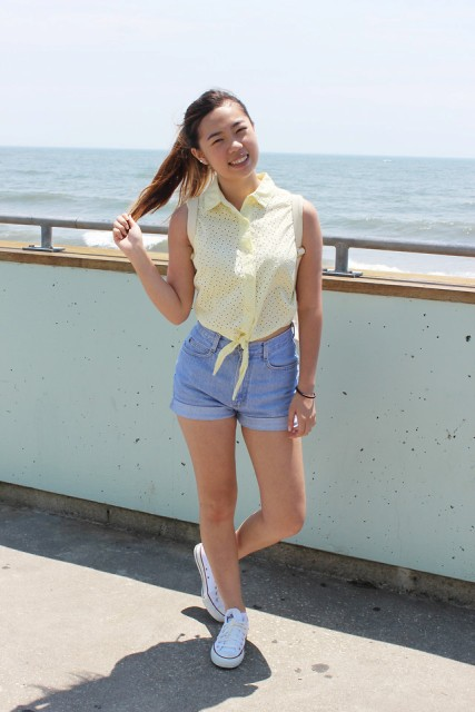 With light yellow top and white sneakers