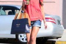With loose blouse, yellow sandals and orange bag