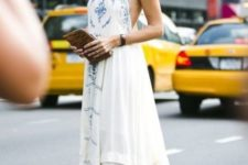 With maxi dress and clutch