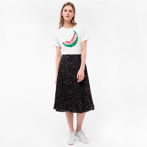 With midi skirt and white sneakers