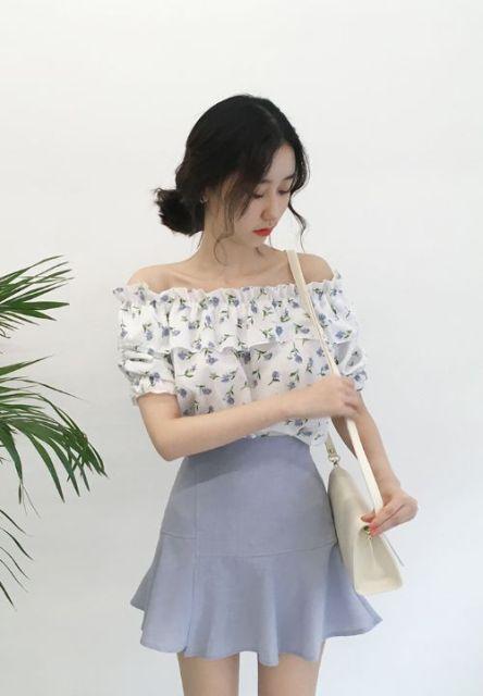 With mini skirt and white bag
