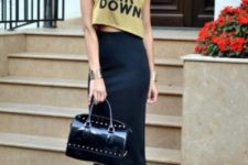 With navy blue midi skirt, cutout boots and black leather bag