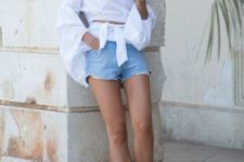 With off the shoulder blouse, denim mini shorts and wide brim hat