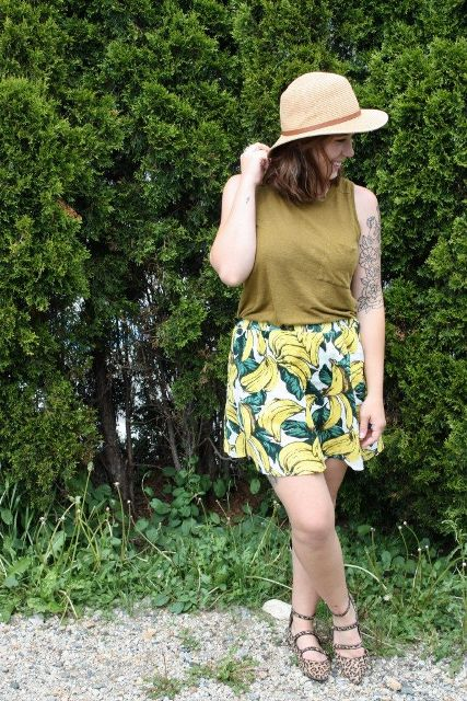 With olive green top, hat and leopard flats