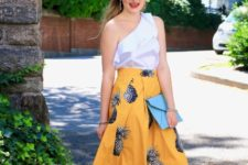 With one shoulder top, blue clutch and red shoes