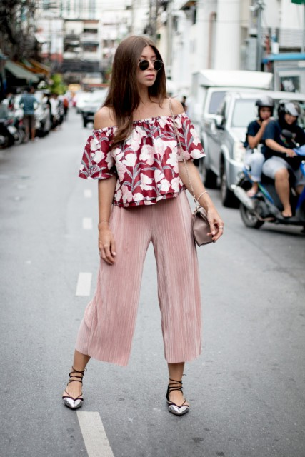 With pale pink culottes, small bag and lace up flats