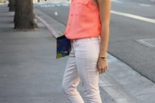 With peach shirt, white pants and clutch