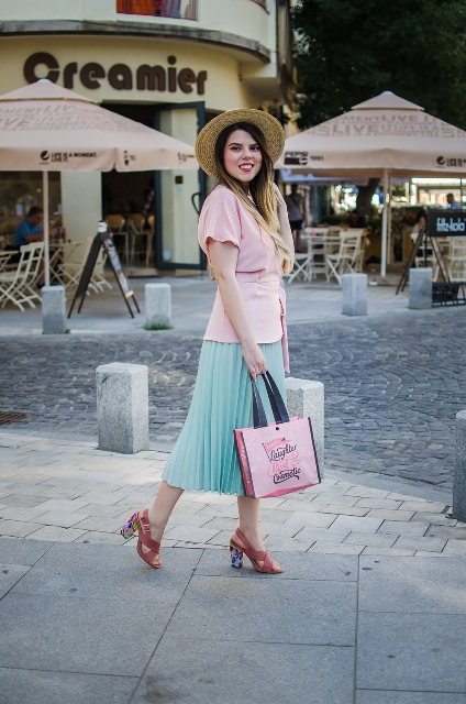 With pleated skirt, hat, pink sandals and tote