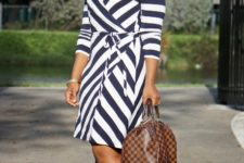 With printed bag and brown leather high heels