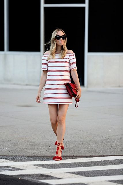 With red clutch and red ankle strap heels