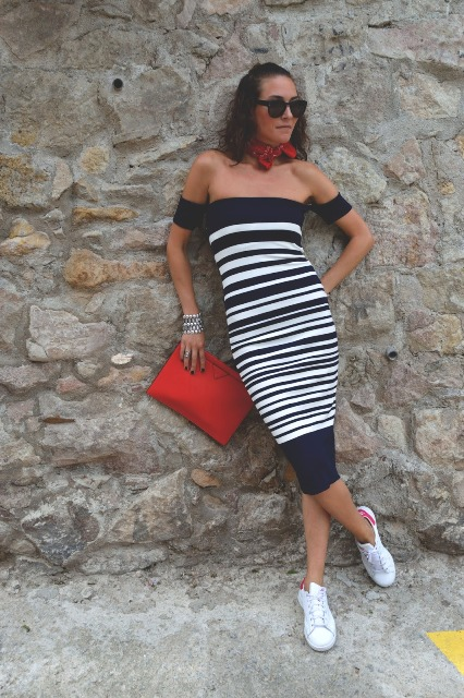 With red clutch, printed scarf and white shoes