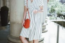 With red crossbody bag and black mules