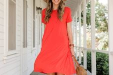 With red dress and wide brim hat