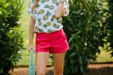 With red shorts, light blue bag and flat sandals