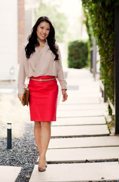 With red skirt, leopard printed shoes and clutch